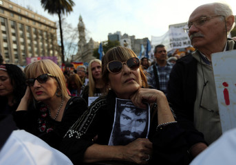 A woman holds a portrait of missing protester Maldonado during a demonstration to demand actions to find him in Buenos Aires