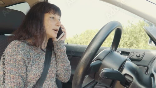 Angry woman talking on the phone in car  Slow Motion