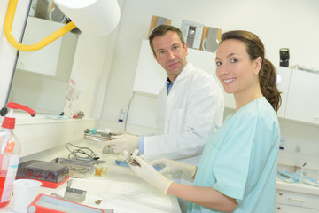 male and female researchers working at laboratory with analysis