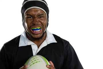 Portrait of male rugby player wearing mouthguard white holding