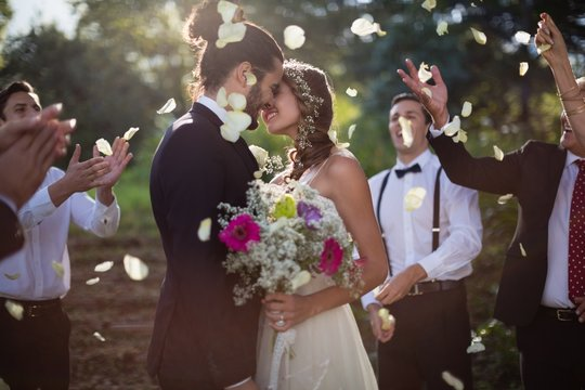Affectionate bride and groom kissing on their wedding day