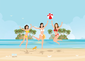 Three bikini woman jumping with ball on beautiful beach on tropical vacation.