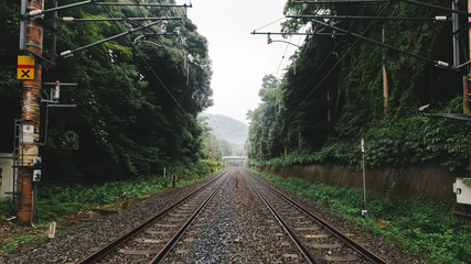 Railroad tracks in kyoto, Japan. Near bamboo groves and is tourist in Japan.