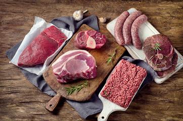 Keuken foto achterwand Vlees Different types of raw meat on dark wooden background.
