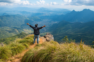 One man standing on the edge of Phu Chi Fa an iconic natural attraction in Chiang Rai the northern province of Thailand.