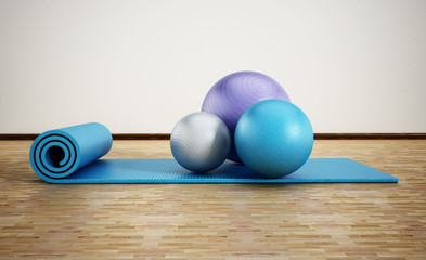 Pilates mat and exercise balls standing on parquet floor. 3D illustration