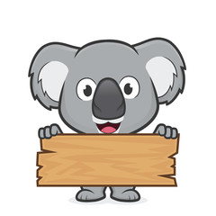 Koala holding a plank of wood