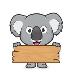 Fototapeta premium Koala trzymająca deskę z drewna