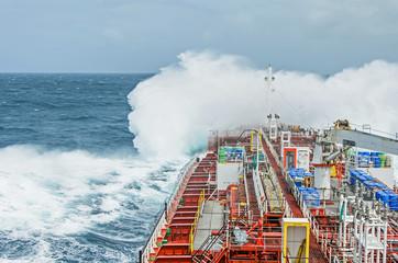 A tanker vessel against rage of the ocean