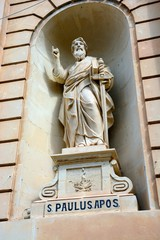 Statue of St Paul in an alcove on the front of the Parish church of our lady of sorrows, Bugibba, Malta.