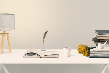 books on a white table with accessoires - Scandinavian style
