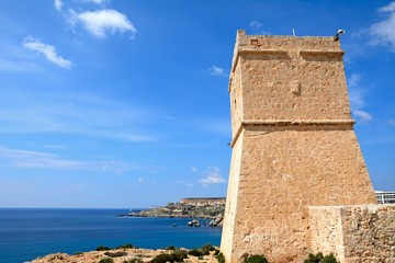 Ghajn Tuffieha watchtower overlooking the sea and cliffs, Golden Bay, Malta.