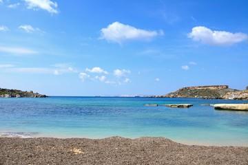 View of Ghaja Tehheiha Bay with a pebble beach in the foreground, Ghajn Tuhheiha Bay, Malta.