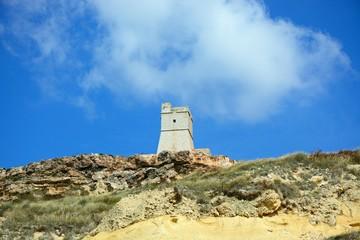 View of Ghajn Tuffieha watchtower which overlooks the coastline, Ghajn Tuhheiha Bay, Malta.
