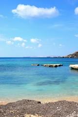 View of Ghaja Tehheiha Bay with a pebble beach in the foreground, Malta.