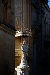 Statue on corner of the Church of Annunciation of our Lady, Mdina, Malta.