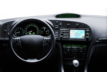 Car interior view with navigation system, steering wheel and instrument dashboard in white background