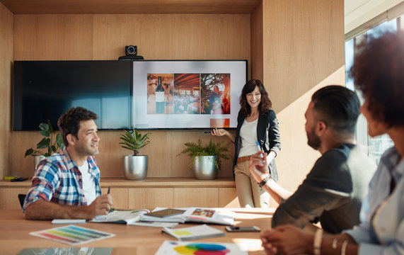 Female coworker making presentation in office