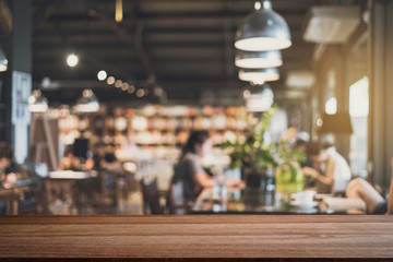 Empty wooden table space platform and blurry defocused restaurant interior, Vintage tone