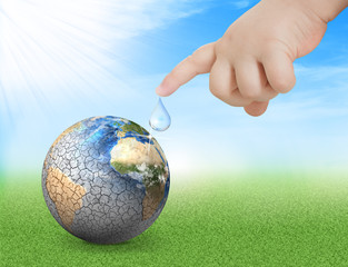 Water drop out of baby hand to dried planet. Earth day concept. World water day. Elements of this image furnished by NASA
