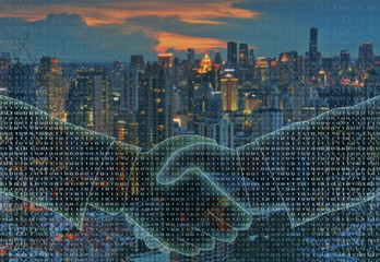 Digital businessman handshake with blur city landscape in the background. Business concept. Abstract image of two hands shaking. Digital partners hand on blue green binary background.
