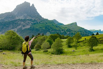 woman hiker with Pic du Midi d'Ossau in the French Pyrenees