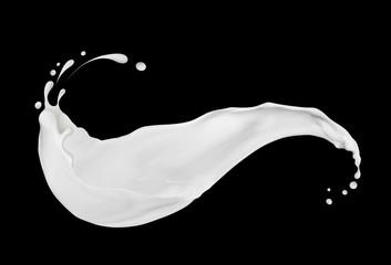 Splashes of cream or milk close-up on black