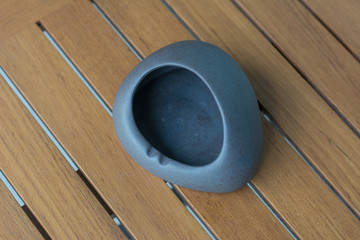 Empty ashtray : Close up ashtray for cigarette smoker on wooden table