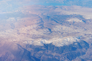 View of the mountains from the height of the aircraft, toned image.