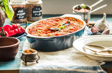 Tasty vegetarian ratatouille made of eggplants, squash, tomatoes and onions.