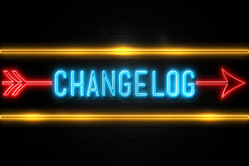 Changelog  - fluorescent Neon Sign on brickwall Front view