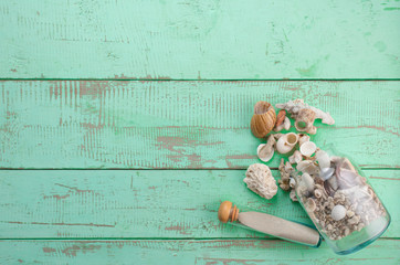 Summer background,Sand and seashells on wooden background