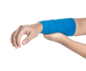 Arm wrapped in elastic bandage on white background,arm pain