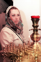 Woman prays in the Russian church