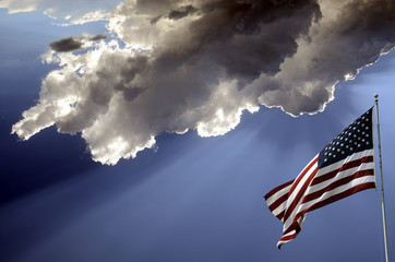 USA flag and cloudy sky