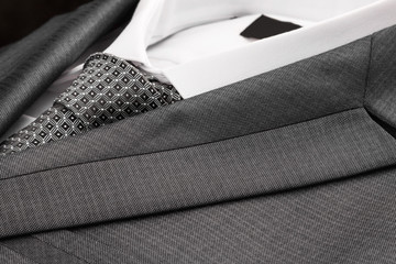 Close-up classic suit, shirt and tie.