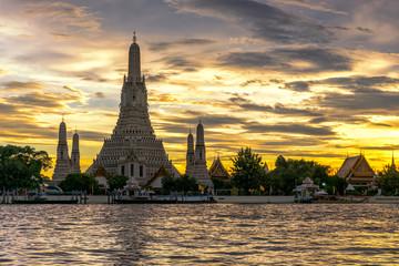 Wat Arun Temple in bangkok thailand at sunset .