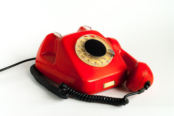 An alarmed old telephone with a put away handset