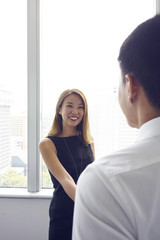 Chinese Female relationship manager closing a deal