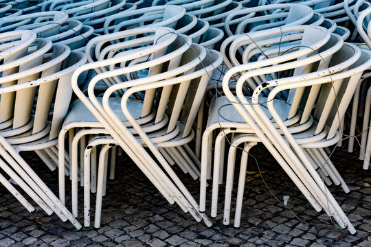 stacked metal chairs