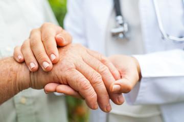 Doctor holding trembling hand