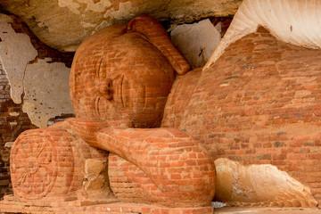 Brick image of dead buddha on the way to the top of Pidurangala, Sigiriya, Sri Lanka