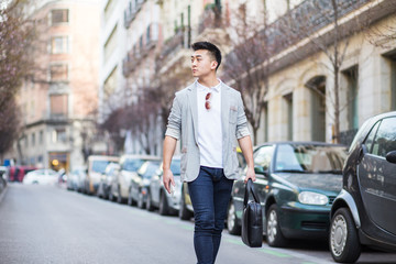 Chinese businessman walking down the street