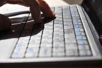 Fototapeta Fingers on the laptop keyboard