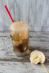 Rootbeer float in frosted mug with vanilla icecream