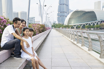 Family chilling at the Esplanade Bridge, Singapore