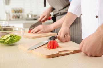 Chef giving cooking classes in kitchen