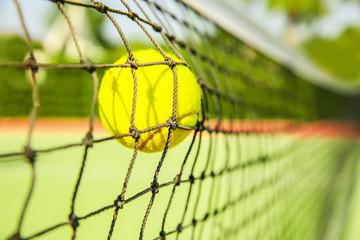 Tennis ball in net, closeup