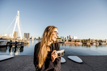 Fototapete - Portrait of a young woman tourist standing on the beautiful morning cityscape background in Rotterdam city
