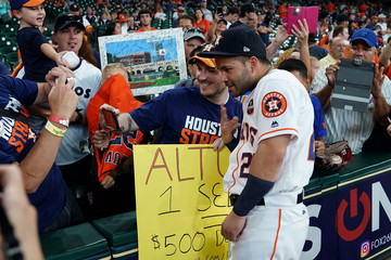 Houston Astros Jose Altuve poses for a photo before the game against the New York Mets in the first game at Minute Maid Stadium after Hurricane Harvey in Houston